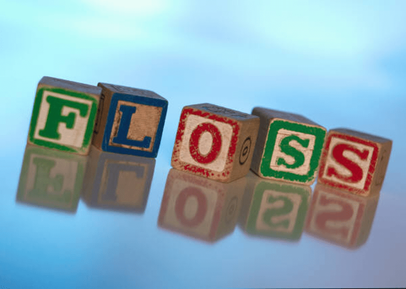 floss pregnancy and teeth maureen piche vancouver dentist wooden blocks